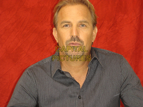 "KEVIN COSTNER.Photocall for ""Swing Vote"", Four Seasons, Wetherly Room, Los Angeles, California, USA..July 23rd, 2008.headshot portrait goatee facial hair black shirt.CAP/AW.©Anita Weber/Capital Pictures."