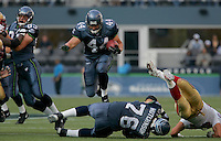 Seahawks runningback Heath Evans(44) jumps over teammate Steve Hutchinson(76) during the game against San Francisco 49ers at Qwest Field in Seattle on September 26, 2004.
