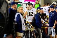 Blacksburg, VA - OCT 6, 2018: Notre Dame Fighting Irish quarterback Ian Book (12) on the phone after a second half touchdown during game between Notre Dame and Virginia Tech at Lane Stadium/Worsham Field Blacksburg, VA. (Photo by Phil Peters/Media Images International)