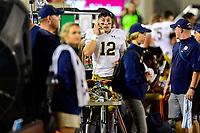 Blacksburg, VA - OCT 6, 2018: Notre Dame Fighting Irish quarterback Ian Book (12) on the phone after a second half touchdown during game between Notre Dame and Virginia Tech at Lane Stadium/Worsham Field Blacksburg, VA. (Photo by Phil Peters/Media Images International)