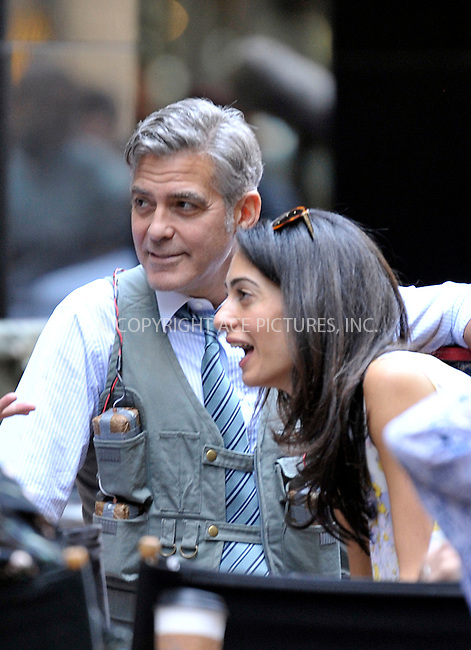 WWW.ACEPIXS.COM<br /> <br /> April 18 2015, New York City<br /> <br /> Actor George Clooney was joined by his wife Amal Clooney on the set of Money Monster on April 18 2015 in New York City<br /> <br /> By Line: Curtis Means/ACE Pictures<br /> <br /> <br /> ACE Pictures, Inc.<br /> tel: 646 769 0430<br /> Email: info@acepixs.com<br /> www.acepixs.com