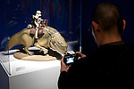 A member of the press takes pictures of a character of the film series Star Wars during a press tour of the exhibition Star Wars Vision at the Tokyo City View Sky Gallery in Roppongi Hills on April 28, 2015, Tokyo, Japan. The exhibition is divided into six themed areas (Original, Force, Battle, Saga, Galaxy and Droid) located in different halls, and visitors can see models of the battle spaceships, life-size statues of the principal characters and Jedi weapons from the movies. The exhibition also introduces 60 art pieces and 100 movie props. It will open to the public from April 29th to June 28th. (Photo by Lucasfilm/Rodrigo Reyes Marin/AFLO)