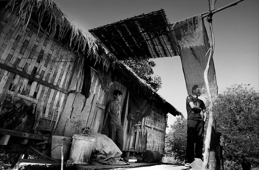 "Mekong Dam Victims - Cambodia. One of the new houses constructed by the villagers far from the river to avoid the flodings caused by the dam. At least 55.000 people living near the Sesan river in Cambodia's Ratanakiri and Stung Treng provinces continue to suffer due to lost rice production, lost fishing income, drowned livestock and damaged vegetable gardens, and so also great economical losses, because of the unpredictable floodings from the Yali Falls Dam on the other side of the border in Vietnam. To this day, flash floodings have caused the deaths of at least 39 villagers from various ethnic minority groups living along the river. Despite this, four other major hydropower projects are now in operation or under construction on the Sesan River in Vietnam. Known as ""The Mother of Waters"", more than 60 million people depend on the Mekong river and its tributaries for food, fresh water, transport and other aspects of daily life. The construction of big dams is now threatening the life of these people aswell as the vital and unique ecosystem of the river."