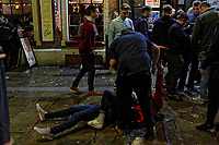 Pictured: Two Christmas revellers lay on the ground in Wind Street, Swansea, Wales, UK. Friday 20 December 2019<br /> Re: Black Eye Friday (also known as Black Friday, Mad Friday, Frantic Friday) the last Friday before Christmas, in Swansea, Wales, UK.