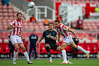 27th June 2020; Bet365 Stadium, Stoke, Staffordshire, England; English Championship Football, Stoke City versus Middlesbrough; James Chester of Stoke City heads the ball back to Goalkeeper Jack Butland
