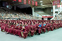 Siloam Springs graduates go through commencement ceremonies on Saturday at Barnhill Arena in Fayetteville.