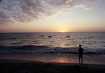 Boy watching sunset on Sanibel Island