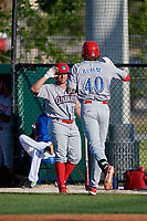 Clearwater Threshers Alec Bohm (40) high fives Ben Aklinski (15) after hitting a home run during a Florida State League game against the Dunedin Blue Jays on May 11, 2019 at Jack Russell Memorial Stadium in Clearwater, Florida.  Clearwater defeated Dunedin 9-3.  (Mike Janes/Four Seam Images)