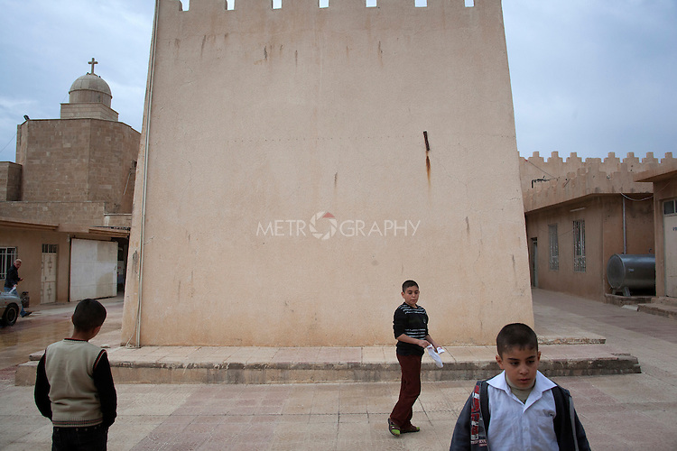 16/11/14. Alqosh, Iraq. Wassam (centre) and Milad (right) play outside in a courtyard of the Monastery located next to the orphanage.