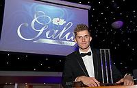 Picture by Allan McKenzie/SWpix.com - 05/10/17 - Cricket - Yorkshire County Cricket Club Gala Dinner 2017 - Elland Road, Leeds, England - Ben Coad with his awards.