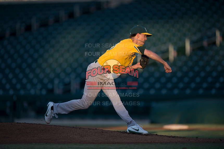 AZL Athletics starting pitcher Calvin Coker (45) follows through on his delivery during an Arizona League game against the AZL Cubs 1 at Sloan Park on June 28, 2018 in Mesa, Arizona. The AZL Athletics defeated the AZL Cubs 1 5-4. (Zachary Lucy/Four Seam Images)