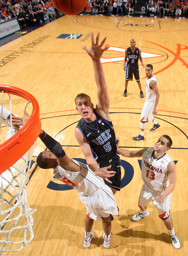 Feb. 16, 2011; Charlottesville, VA, USA; Duke Blue Devils forward Mason Plumlee (5) shoots over Virginia Cavaliers forward Akil Mitchell (25) and Virginia Cavaliers guard Sammy Zeglinski (13) during the second half of the game at the John Paul Jones Arena. The Duke Blue Devils won 56-41. Credit Image: © Andrew Shurtleff