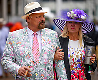 LOUISVILLE, KY - MAY 06: A man smokes a cigar as he walks with a woman drinking coffee on Kentucky Derby Day at Churchill Downs on May 6, 2017 in Louisville, Kentucky. (Photo by Scott Serio/Eclipse Sportswire/Getty Images)