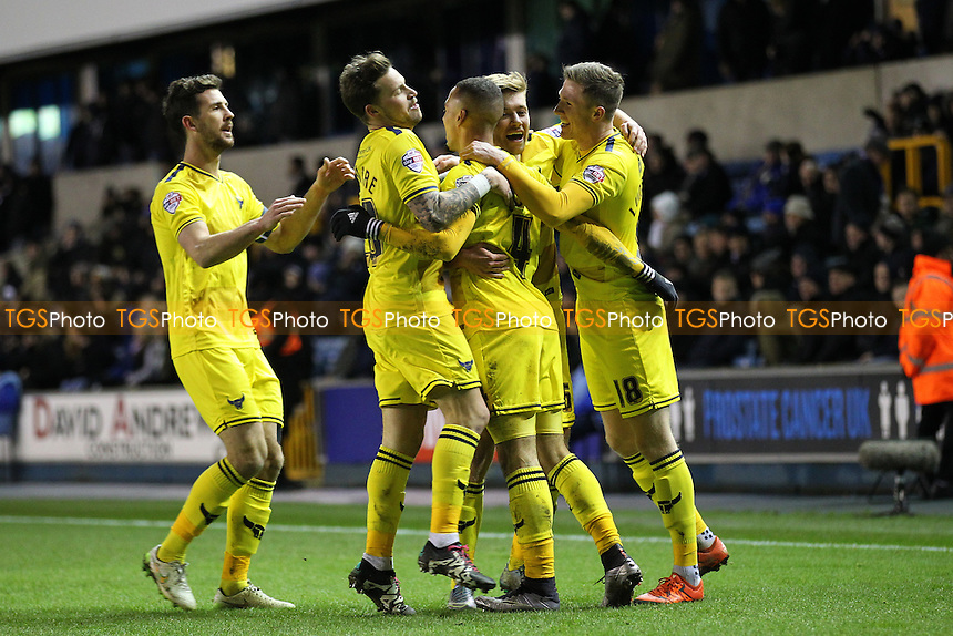 Kemar Roofe of Oxford United scores the second goal for his team and celebrates with his team mates during Millwall vs Oxford United at The Den
