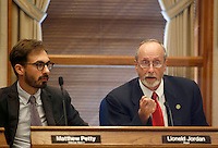 NWA Media/DAVID GOTTSCHALK - 8/19/14 - Matthew Petty, alderman ward 2, left, listens to Lioneld Jordan, mayor of the city of Fayetteville, as describes the procedures for the public comment at the Fayetteville City Administration Building August 19 , 2014 during the Fayetteville City Council  meeting. The public comment section of the meeting drew a large public turnout and response to a proposed anti-discrimination ordinance sponsored by Ward 2 Alderman Matthew Petty which would prohibit certain types of discrimination based on sexual orientation and gender identity and would create a municipal civil rights administrator position.