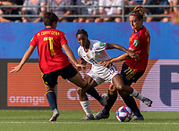 REIMS,  - JUNE 24: Marta Corredera #7 is split by Crystal Dunn #19 as she runs past Alexia Putellas #11 during a game between NT v Spain and  at Stade Auguste Delaune on June 24, 2019 in Reims, France.