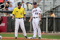 March 21, 2010:  Mike Kittle (8) of the Michigan Wolverines on first with NY Mets Daniel Murphy (28) during a game at Tradition Field in St. Lucie, FL.  Photo By Mike Janes/Four Seam Images