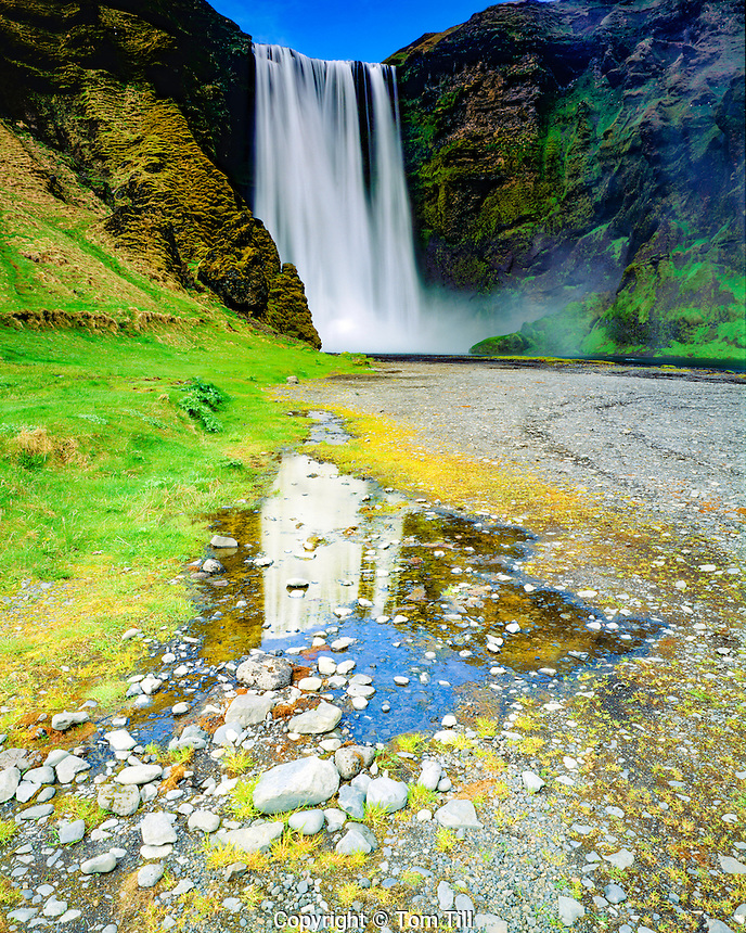 Falls and Reflection, Skogafoss Waterall, Iceland, North Atlantic Ocean, Glacial melt over volcanic dams, May