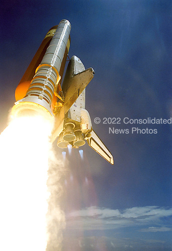 Kennedy Space Center, FL - July 4, 2006 -- Space Shuttle Discovery and its seven-member crew launched at 2:38 p.m. (EDT) to begin the two-day journey to the International Space Station on the historic Return to Flight STS-121 mission. Discovery is slated to dock with the station at 10:52 a.m. (EDT) Thursday July 6, 2006. The shuttle made history as it was the first human-occupying spacecraft to launch on Independence Day. During the 12-day mission, the STS-121 crew of seven will test new equipment and procedures to improve shuttle safety, as well as deliver supplies and make repairs to the space station..Credit: NASA via CNP