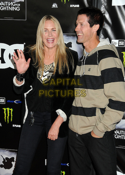 "Daryl Hannah, Danny Way.""Waiting For Lightning"" Los Angeles Screening held at The Cinerama Dome, Hollywood, California, USA..April 10th, 2012.half length top beige black striped stripes smiling mouth open profile.CAP/ADM/BP.©Byron Purvis/AdMedia/Capital Pictures."