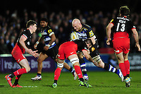 Matt Garvey of Bath Rugby takes on the Saracens defence. Aviva Premiership match, between Bath Rugby and Saracens on April 1, 2016 at the Recreation Ground in Bath, England. Photo by: Patrick Khachfe / Onside Images
