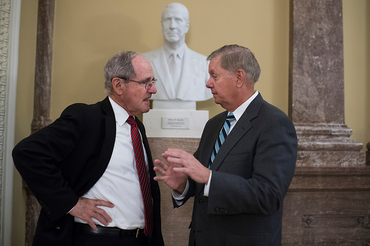 UNITED STATES - JUNE 5: Sens. Jim Risch, R-Idaho, left, and Lindsey Graham, R-S.C., talk after the Senate Policy luncheons in the Capitol on June 5, 2018. (Photo By Tom Williams/CQ Roll Call)