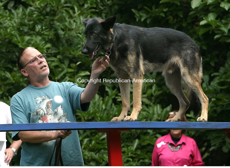 BETHLEHEM, CT, 16 SEPTEMBER 2006, 091606BZ14- Jack Crann, of Peace of Mind Canine in Bethlehem, uses his German Shepherd &quot;Gatsby&quot; to demonstrate crossing a bridge<br /> during the fifth annual Bellamy-Ferriday House Dog Show Saturday afternoon.<br />  Jamison C. Bazinet Republican-American