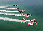 A of five of the worlds best aerobatic pilots including from front the French Connection team of Montaine Mallett and Daniel Heligon, Sean D. Tucker, Leo Loudenslager, and Steve Oliver flies over the Atlantic off the coast of Flagler Beach, Fla., Friday, April 4, 1997.(Daytona Beach News-Journal, Brian Myrick)