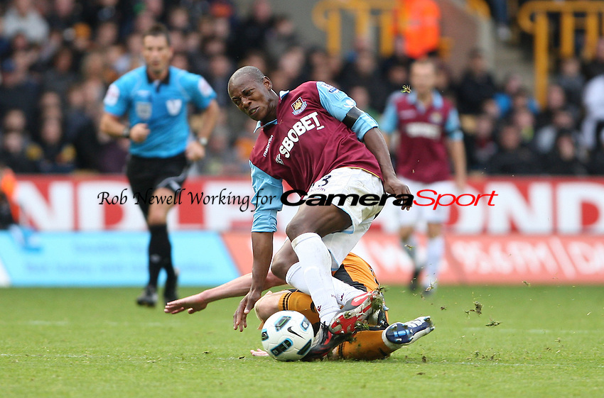 Luis Boa Morte of West Ham on the end of a tough Wolves challenge - Wolverhampton Wanderers vs West Ham United, Barclays Premier League at Molineaux, Wolverhampton - 16/10/10 - MANDATORY CREDIT: Rob Newell/TGSPHOTO - Self billing applies where appropriate - 0845 094 6026 - contact@tgsphoto.co.uk - NO UNPAID USE.