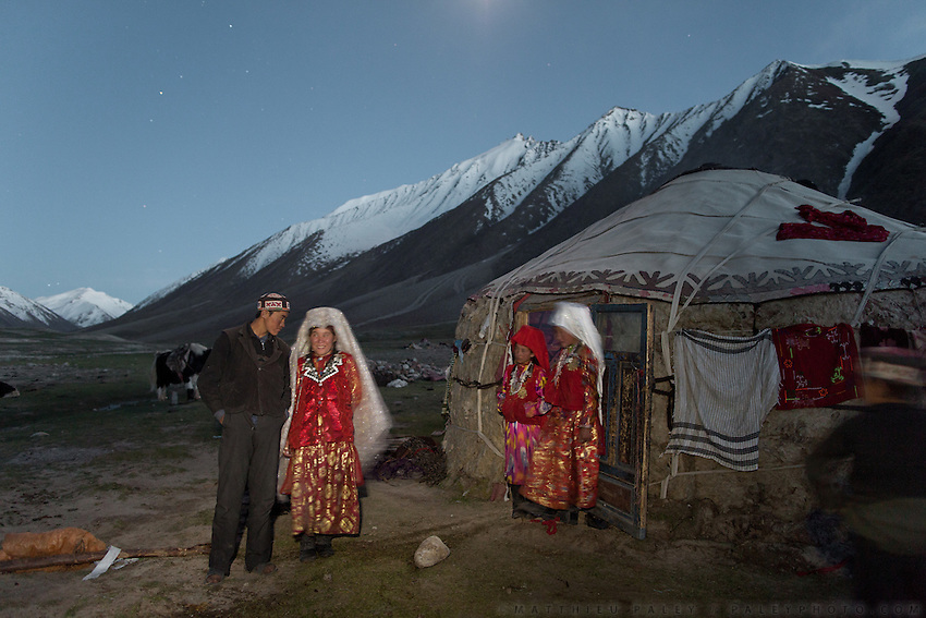 Nemat Ullah and his wife Woolook Bu, a newly married couple, pose in front of their yurt...Daily life at the Khan (chief) summer camp of Kara Jylga...Trekking through the high altitude plateau of the Little Pamir mountains (average 4200 meters) , where the Afghan Kyrgyz community live all year, on the borders of China, Tajikistan and Pakistan.