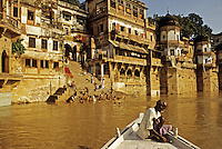 India. Ganges Ghats and boatman. Varansi, formerly Benares, Hindu holy city on the Ganges River.  One of the world's most ancient cities.