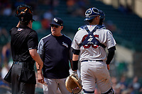 Scranton/Wilkes-Barre RailRiders manager Jay Bell (22) argues a call with umpire John Bacon as catcher Kyle Higoshioka (66) looks on during an International League game against the Rochester Red Wings on June 25, 2019 at Frontier Field in Rochester, New York.  Rochester defeated Scranton 10-9.  (Mike Janes/Four Seam Images)