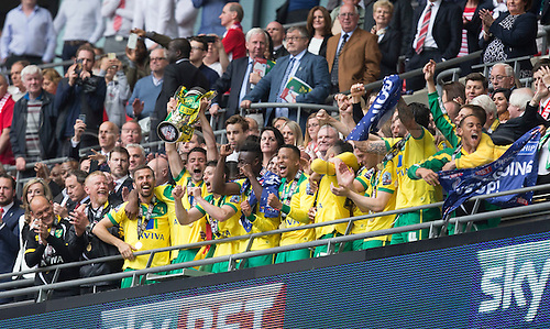 25.05.2015.  London, England. Skybet Championship Playoff Final. Middlesborough versus Norwich. Norwich City's Russell Martin lifts the cup after his sides victory as they get promoted to the Premiership.