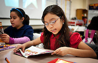 Valera Pruneda (cq, age 8) reads both English and Spanish books during Gilda Martinez's third grade bi-lingual class at C. M. Macdonnell Elementary School in Laredo, Texas, US, Tuesday, Dec., 8, 2009. With over 95 percent of the population as Hispanic Spanish speakers, Laredo ranked the lowest in literacy rates in the 2000 US census. Today there are a number of bi-lingual and dual language classes set up to help students and adults learn english...PHOTOS/ MATT NAGER