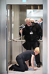 © Joel Goodman - 07973 332324 . No syndication permitted . 14/11/2013 . Manchester , UK . The lift allocated to the royal party is cleaned and polished ahead of the visit . Queen Elizabeth II and the Duke of Edinburgh visit the Coop building at 1 Angel Square , Manchester , this morning ( 14th November 2013 ) . Photo credit : Joel Goodman