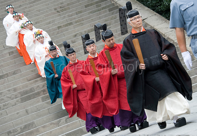 Shrine priests and female maiko attendants walk from the main hall following a ritual in the main hall of Tsurugaoka Hachimangu shrine during the second day of the 3-day Reitaisai grand festival in Kamakura, Japan on  15 Sept. 2012.  Photographer: Robert Gilhooly