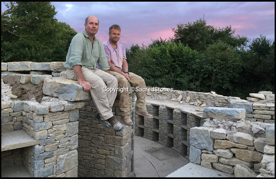 BNPS.co.uk (01202 558833)<br /> Pic: SacredStones/BNPS<br /> <br /> Toby Angel(l) is behind the building boom.<br /> <br /> Building boom after 4000 years - Neolithic barrows are being built again as burial mounds for modern Britons.<br /> <br /> Prehistoric tombs used to store the ashes of loved ones are being built on UK soil for the first time in thousands of years. <br /> <br /> Until now Neolithic earth mounds built over the dead, known as long barrows, had not been used since around 2,000 BC. <br /> <br /> The limestone frame covered in soil and grass was entirely handmade by a team of four stonemasons using traditional techniques over the course of five months. <br /> <br /> The firm will be selling 400 plots, or niches, near Hail Weston, Cambs, for between £1,950 and £4,800.