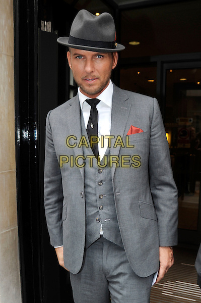 MATT GOSS .Seen meeting fans and signing autographs outside BBC Radio 2, London, England, UK,.October 14th 2010..half length grey gray suit waistcoat hat trilby white shirt black tie beard facial hair eye contact red pocket .CAP/IA.©Ian Allis/Capital Pictures.