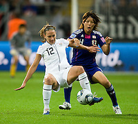 Lauren Cheney (12) of the United States fights for the ball with Saki Kumagai (4) of Japan during the final of the FIFA Women's World Cup at FIFA Women's World Cup Stadium in Frankfurt Germany.  Japan won the FIFA Women's World Cup on penalty kicks after tying the United States, 2-2, in extra time.