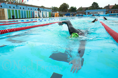28 SEP 2013 - LONDON, GBR - Rod Elder prepares to touch the wall at the end of another length of the pool during his 7.3 mile swim at Charlton Lido in London, Great Britain as part of the Enduroman 2013 Lands End to London to Dover ultra triathlon (PHOTO COPYRIGHT © 2013 NIGEL FARROW, ALL RIGHTS RESERVED)