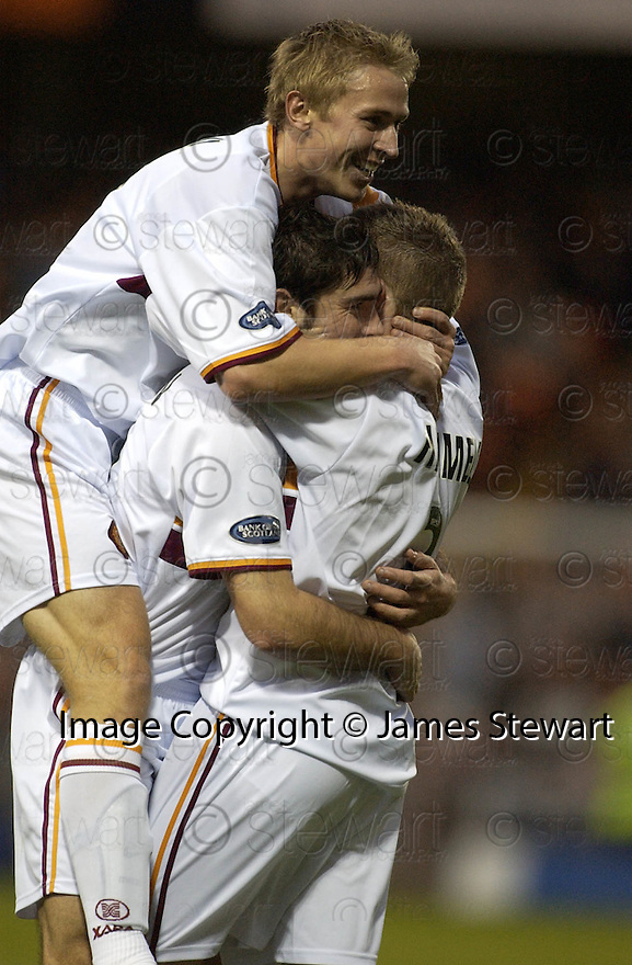 04/12/2004  Copyright Pic : James Stewart.File Name : jspa03_dundee_utd_v_motherwell.JIM PATERSON IS CONGRATULATED AFTER HE SCORES MOTHERWELL'S FIRST....Payments to :.James Stewart Photo Agency 19 Carronlea Drive, Falkirk. FK2 8DN      Vat Reg No. 607 6932 25.Office     : +44 (0)1324 570906     .Mobile   : +44 (0)7721 416997.Fax         : +44 (0)1324 570906.E-mail  :  jim@jspa.co.uk.If you require further information then contact Jim Stewart on any of the numbers above.........
