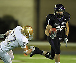 ROME, GA - DECEMBER 18: Kristian Porter #26 of the University of Sioux Falls tries to get a step past Tucker Vezina  #27 of Carroll College in the third quarter at Barron Stadium in the 2010 NAIA National Football Championship in Rome, GA.(photo by Dave Eggen/Inertia)