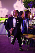 United States President Barack Obama listens as Prime Minister David Cameron of the United Kingdom offers a toast during the Official Dinner on the South Lawn of the White House, March 14, 2012. Samantha Cameron is seated at right. .Mandatory Credit: Pete Souza - White House via CNP