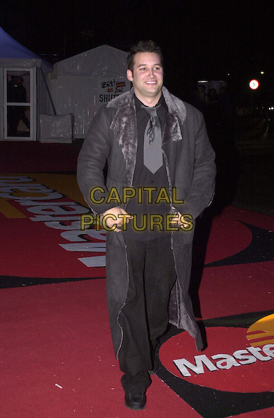 DANE BOWERS.Arrivals for the Brit Awards at Earls Court.  .short tie, fur collar coat, full length, full-length.*RAW SCAN - photo will be adjusted for publication*.www.capitalpictures.com.sales@capitalpictures.com.© Capital Pictures