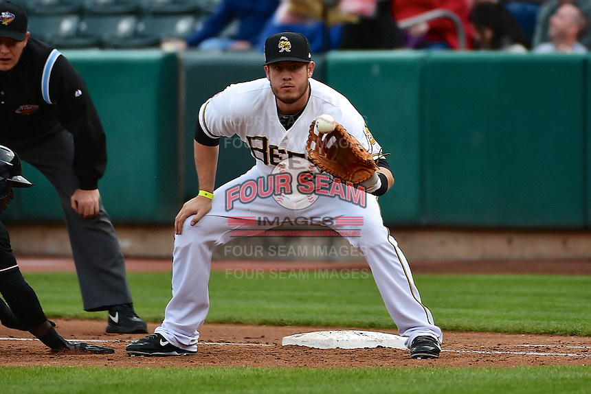 C.J. Cron (24) of the Salt Lake Bees on defense against the Albuquerque Isotopes at Smith's Ballpark on April 21, 2014 in Salt Lake City, Utah.  (Stephen Smith/Four Seam Images)