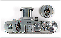 BNPS.co.uk (01202 558833)Pic: Astons/BNPS<br /> <br /> The victorious Soviets took the world famous Leica factory back to Russia after WW2 and started making Russian Leicas under the FED and Zorky brand names.<br /> <br /> Cold War Collectables - Auction of Soviet spy camera's from behind the Iron Curtain reveal the KGB's cunning and ingenuity at the height of the Cold War.<br /> <br /> A fascinating collection of Russian spy cameras which were used clandestinely at the height of the Cold War have emerged for sale for &pound;60,000.<br /> <br /> The ingenious gadgets deployed by KGB operatives include cameras built into the sides of briefcases, buttons of jackets, umbrella handles and cigarette cases.<br /> <br /> The sale also features a clever 'Zenit' F-21 spy camera which shoots photos through the side of a camera case when it appears to be shut.<br /> <br /> There are also several 'Minox' cameras which are known as the 'James Bond' spy camera as one appeared in the film On Her Majesty's Secret Service (1969).
