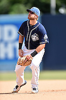 Asheville Tourists first baseman Brian Mundell (15) reacts to the ball during a game against the Hagerstown Suns and the  at McCormick Field on September 5, 2016 in Asheville, North Carolina. The Suns defeated the Tourists 9-5. (Tony Farlow/Four Seam Images)