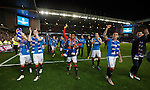 Rangers players celebrate gaining promotion to the Premiership