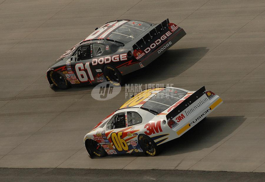 Sept. 23, 2006; Dover, DE, USA; Nascar Busch Series driver Steve Wallace (61) battles Todd Kluever (06) during the Dover 200 at Dover International Speedway. Mandatory Credit: Mark J. Rebilas
