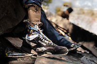 """A young Honduran immigrant, having his leg amputated by a train during his previous attempt to get illegally to the United States, waits near the railroad track to climb up the cargo train in Lechería station, in the outskirts of Mexico City, Mexico, 6 November, 2014. Between 2010 and 2015, the US and Mexico have apprehended almost 1 million illegal immigrants from El Salvador, Honduras, and Guatemala. While the economic reasons remain the most frequent motivation for people from Central America to illegally immigrate to the US, thousands of Salvadorans, Guatemalans, and Hondurans, many of them minors, seek asylum in the US due to the thriving crime and gang-related violence in their region (known as the Northern Triangle). Taking an exhausting and risky journey, riding thousands of miles atop the cargo trains, facing a physical danger and extortion from the organized crime groups that control migrant routes, the """"undocumented"""" still flee to the US, looking for their American dream."""